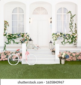 Classic white terrace. Spring pretty background. Spring and Easter mood. Shabby chic style. Country veranda in spring decoration. Backdrop for photography