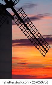 Classic windmill in La Mancha at dawn.