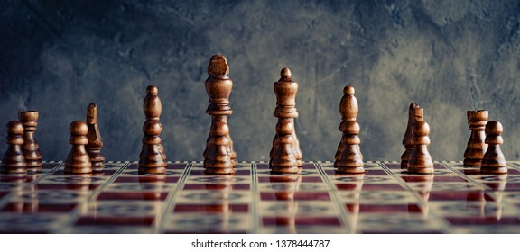 Classic wooden chess figures with reflection on board in front