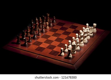 Classic Wooden Chessboard with Chess Pieces against a background