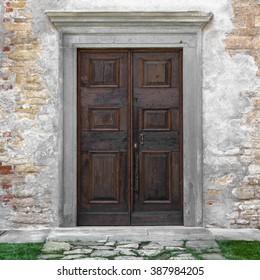 Classic wooden door of an old monastery, in Italy.