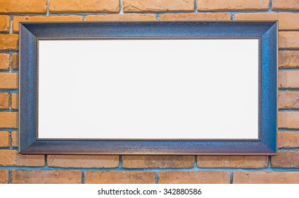 classic wooden frame on brick wall