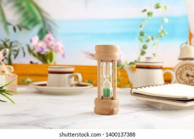 Classic wooden hourglass on the table.