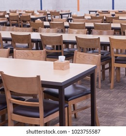 Classic wooden tables and chairs set arrange in convention hall, food court table set prepare for people