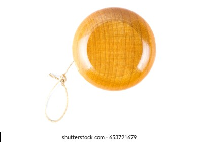 Classic wooden yoyo isolated on white background.