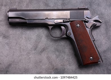 Classic Word War Two . 45 Caliber Semi Automatic Pistol. On a Leather Background