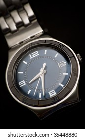 Classic wrist watch on black background