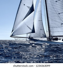 Classic yacht under full sail at the regatta. Sailing team competition