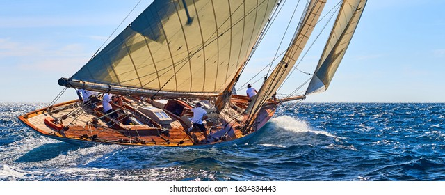 Classic yacht under full sail at the regatta. Sailing yacht race