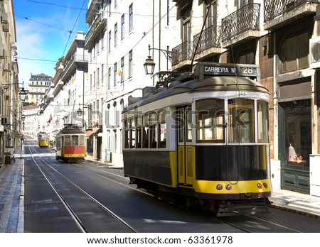 Classic yellow trams (electrics) in downtown Lisbon, Bairro alto, Alfama, Portugal