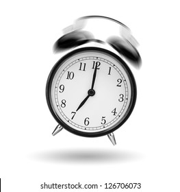 classical alarm clock ringing on white background