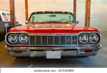 Classical American Vintage car Chevrolet Impala 1964 on Original Meet Show. Russia, St. Petersburg, September 7, 2019. Front view.