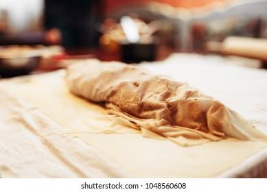 Classical apple strudel prepared for baking