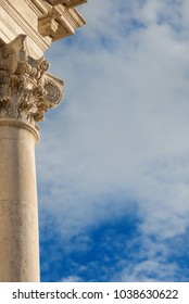 Classical architecture. Old stone column with Corinthian capital from the former Church of Saint Giustina in Venice. built in the 17th century (with clouds and copy space)