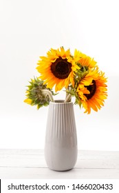 Classical artistic aesthetic, summer flower, still life composition and beauty in nature concept theme with sunflowers in a vase on wood table against white background