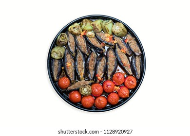 Classical Azerbaijani dolma with eggplant tomatoes and pepper with beef (summer or three sisters of dolma) on a white background