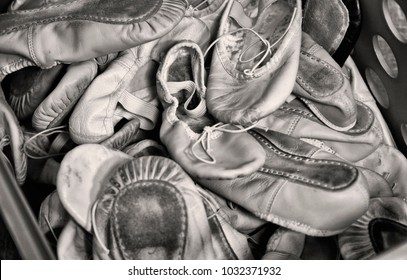 Classical ballet school: box with worn ballet shoes