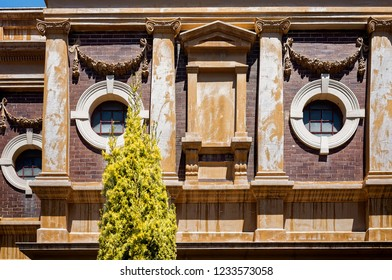 Classical building facade. Old church wall with round windows and architectural elements. Vintage stone house edifice
