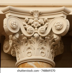 Classical Corinthian style capital on top of marble column