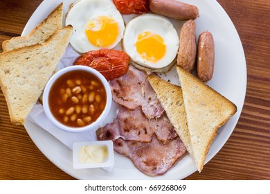 classical english breakfast with egg and ham