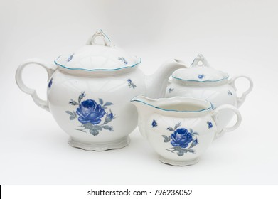 Classical faience tea or coffee serving set isolated - blue rose pattern