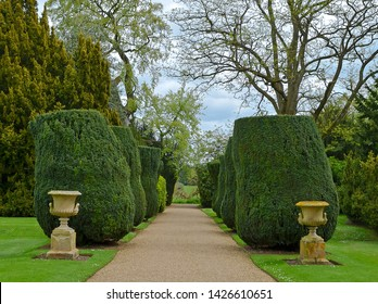 Classical formal English country garden with topiary and ornaments