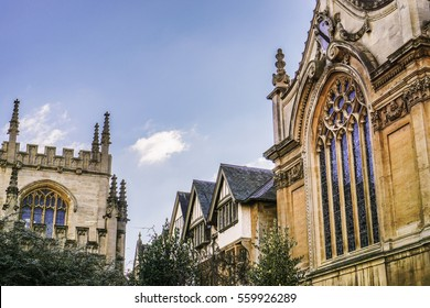 Classical gothic architecture of Oxford, England.  View of roof tops and gorgeous artifact of a window.