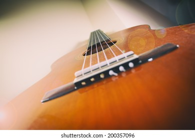 Classical Guitar Lens Flare. A classical acoustic guitar with light and lens flare.