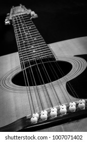 Classical Guitar - Macro of sound hole details, fret, and strings