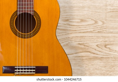 Classical guitar over a wood texture background