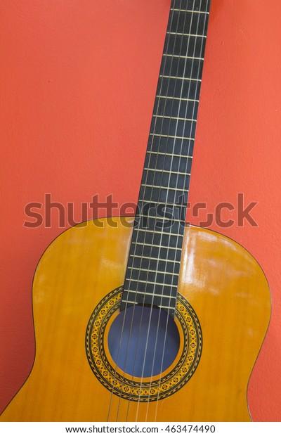 Classical Guitar Wallpaper On Orange Background Stock Image