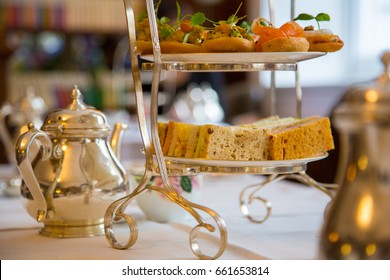 Classical London afternoon tea ceremony with snacks, desserts and traditional tea ceremony.