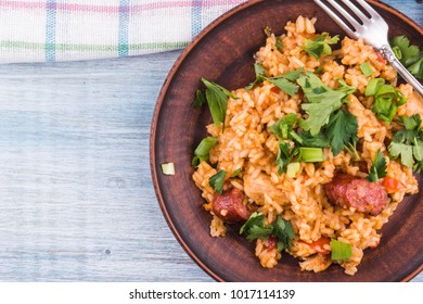 Classical Louisiana Jambalaya from chicken, rice and smoked sausages - copy space, a place for a recipe