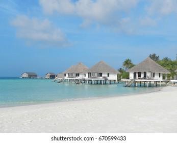Classical Maldives coast with villa