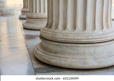Classical marble pillars detail on the facade of a building