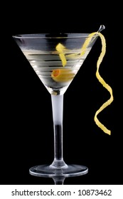 Classical martini in chilled glass over black background on reflection surface, garnished with olive and lemon twist. Most popular cocktails series.