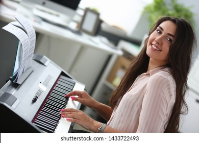 Classical music. Pretty young girl. Home studio interior. Leisure entertainment. Piano keyboard. Portrait woman. People beauty fashion. Active leisure lifestyle.