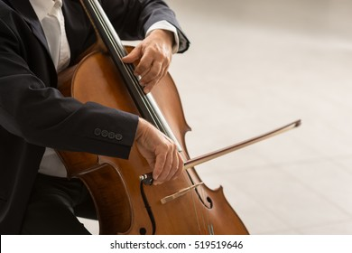 Classical music professional cello player solo performance, hands close up, unrecognizable person