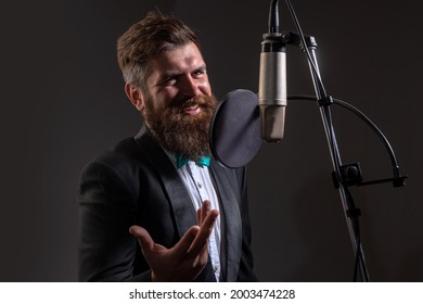 Classical music. Singing man in a recording studio. Expressive bearded man with microphone. Karaoke signer, musical vocalist.