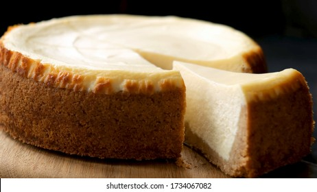 Classical New York Cheesecake With Slice Cut Out. Closeup View