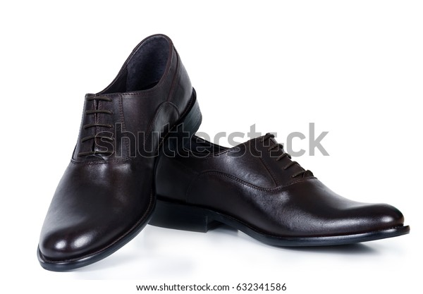 Classical pair of brown male shoes isolated on white background with shadow