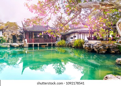 Classical picturesque Chinese garden with pavilions and ponds in the city of Suzhou in the spring, China