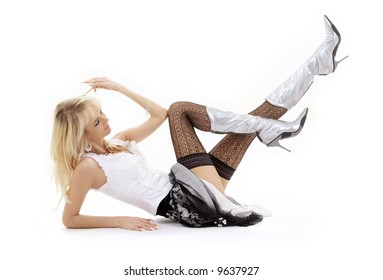 classical pin-up image of laying blonde in silver boots