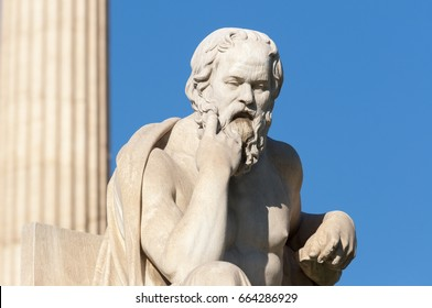 classical statue of Socrates in front of a column