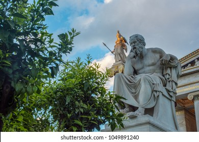 classical statue of Socrates from side with athena statue above