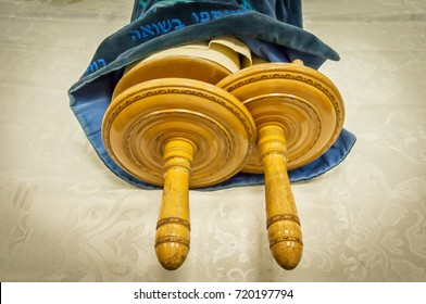 "Classical Torah scrolls in a blue case with Hebrew letters. Torah is used in different religious services in a synagogue, especially during the holidays of the Jewish ""tishrei"" month."