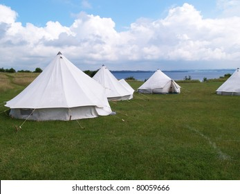 Classical traditional tents in a camping nature site by the beach ocean