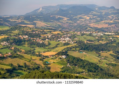 Classical Tuscany landscape in summer. San Marino cityscape on green hills. Italy.