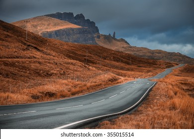 A classical vanishing point of the road on Isle of Skye, Scotland, UK, with a view over the Old Man of Storr peak