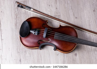 Classical violin isolated on wooden background. Studio shot of old violin. Classical musical instrument